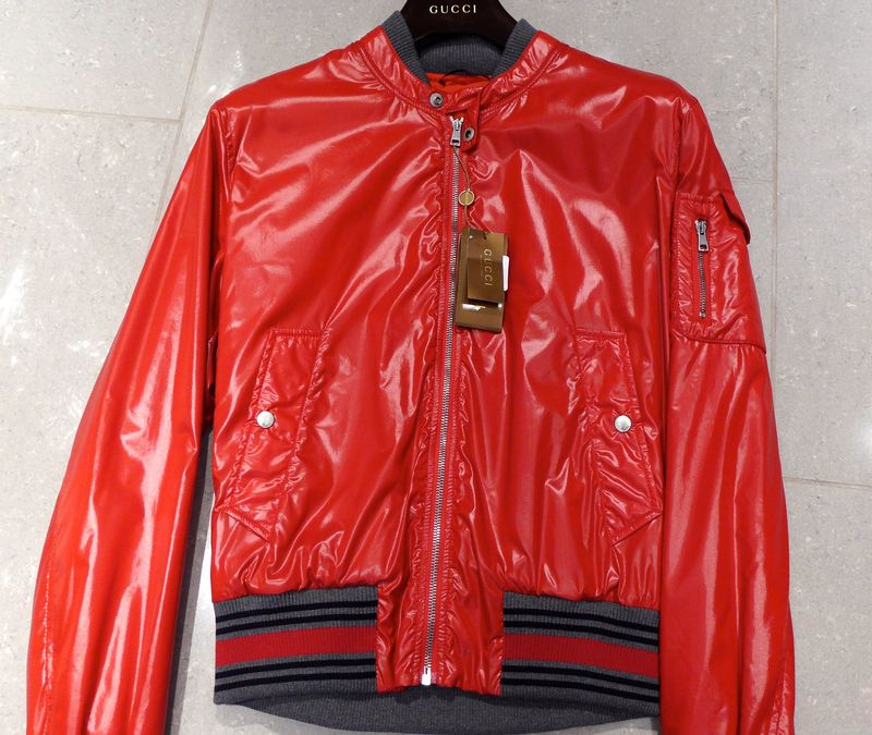 Shiny red jacket on the street