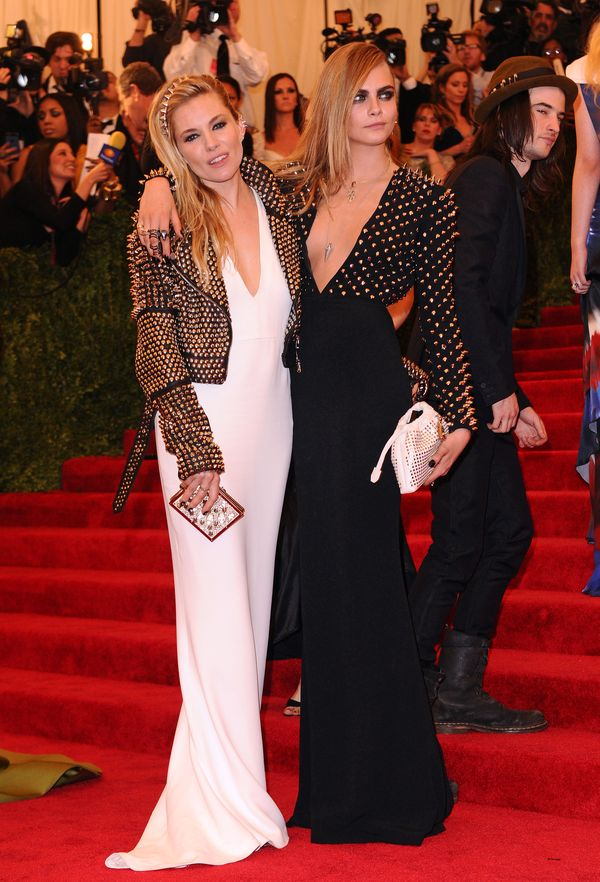 Cara delevingne and sienna miller wearing burberry to the costume institute gala benefit, metropolitan museam of art, new york. 06 may 2013